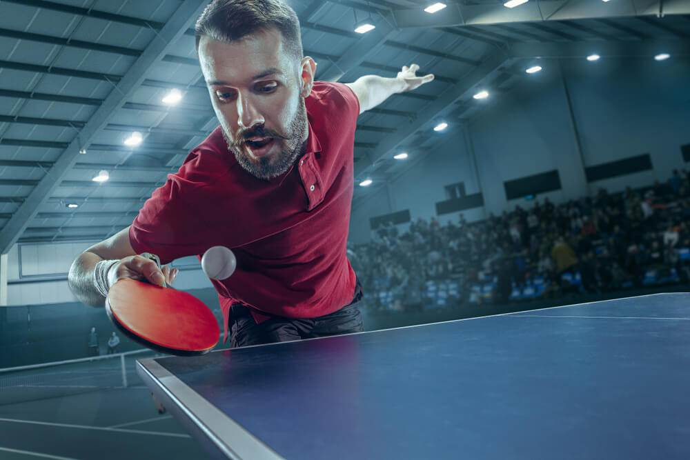 ping pong players touch table